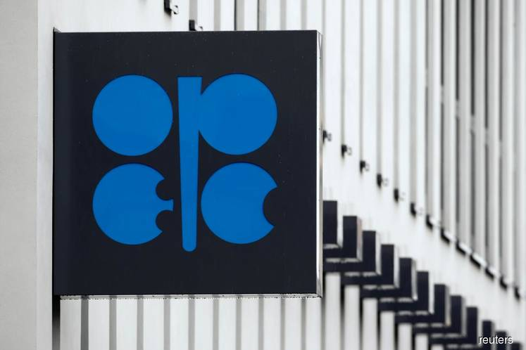 OPEC sees its oil market share shrinking, lowers demand view