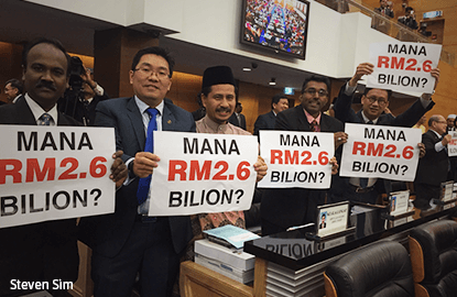 Opposition MPs hold up 'Where is the RM2.6 billion' placards as Najib ends budget speech