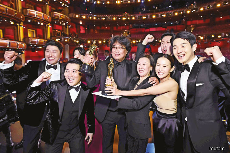 Bong (third from left) and the cast of Parasite posing at the 92nd Academy Awards in Hollywood, Los Angeles, California, the US on Sunday. (Photo by Reuters)