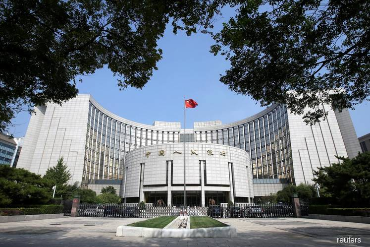 China central bank cuts medium-term loan rate for 1st time since 2016 as growth cools