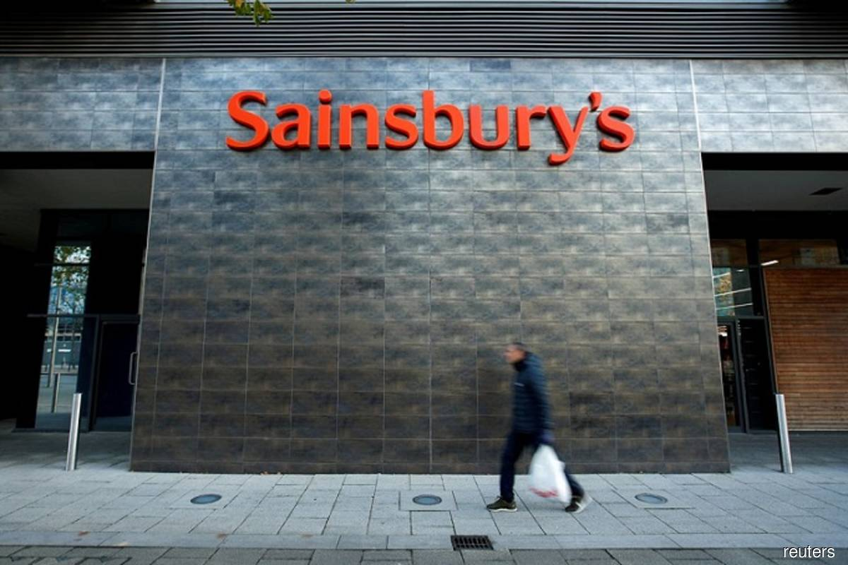 A person walks past a Sainsbury's store in Milton Keynes, Britain on Nov 5, 2020. (Photo by Andrew Boyers/Reuters filepix)
