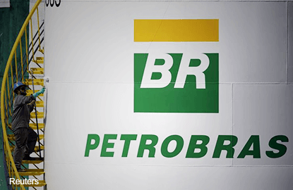 Brazil's Petrobras to cut managers as oil prices sink, says sources