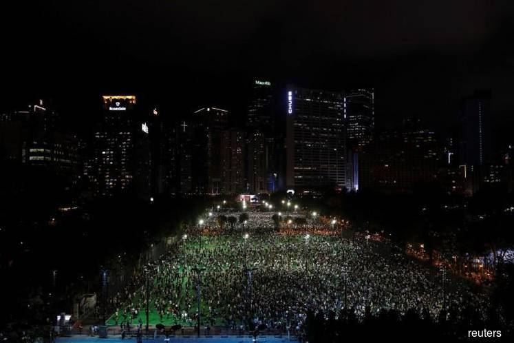 Police pepper spray Hong Kongers defying ban to mark Tiananmen