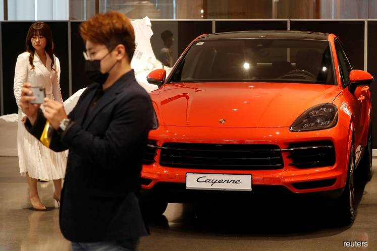 A Porsche Cayenne Coupe seen on display at its dealership during a news conference in Seoul, South Korea on Tuesday.