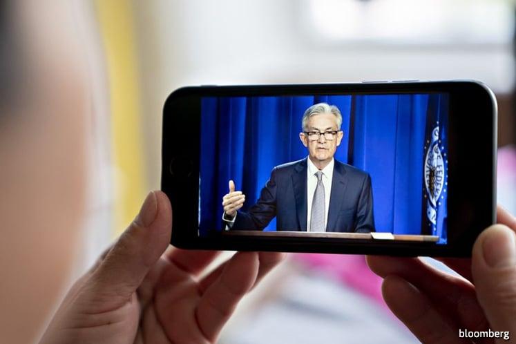 Powell warns of extraordinary uncertainty, urgency to curb virus
