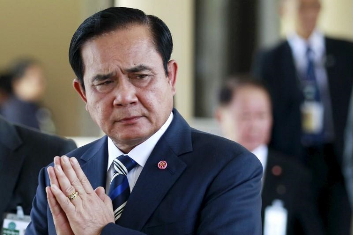 Thai PM vows to stay on as protesters defy his ban