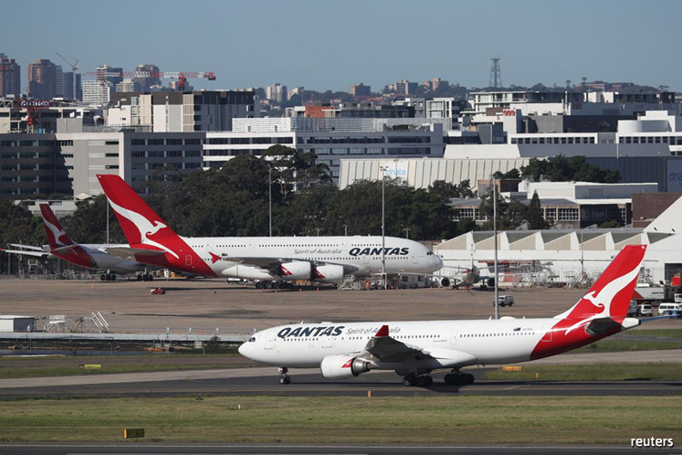 Australia's Qantas to provide in-flight masks but will not leave seats vacant