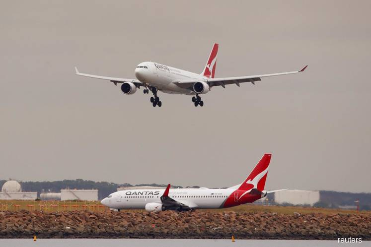 Qantas annual profit drops, hit by higher fuel costs