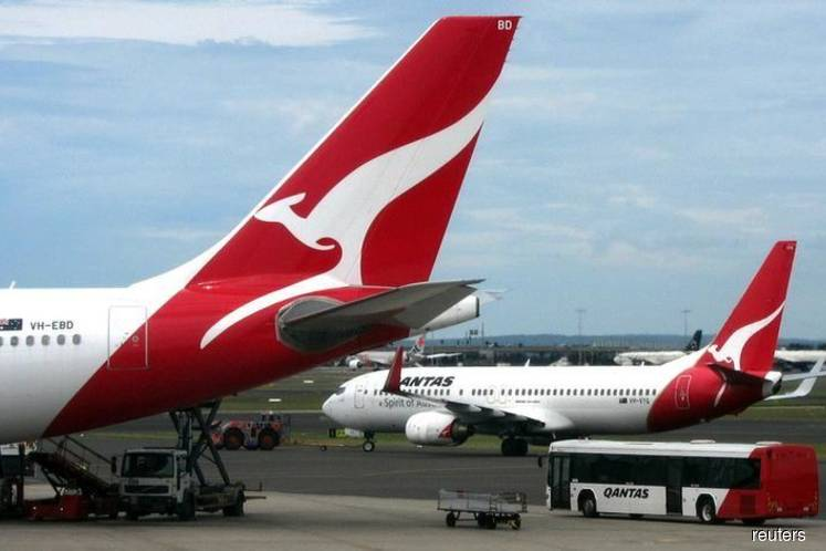Qantas axes flights across Asia as virus scares off flyers