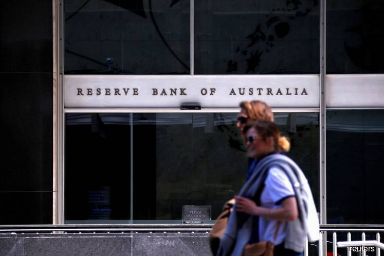 Australia's central bank holds rates as it weighs past cuts