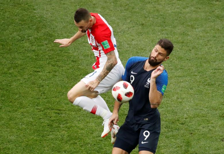 Croatia's Marcelo Brozovic in action with France's Olivier Giroud