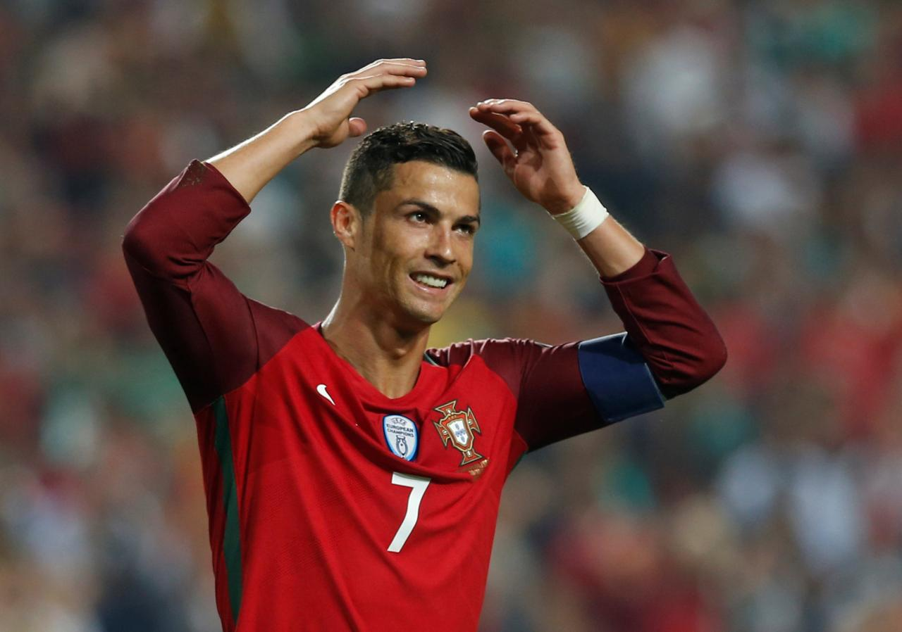 Magic Ronaldo lights up World Cup with hat-trick to deny Spain