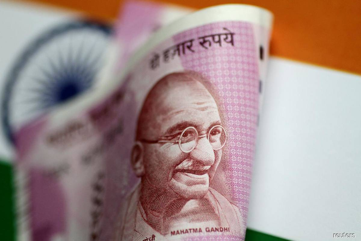 Rupee jumps as central bank steps back, Asian stocks rally