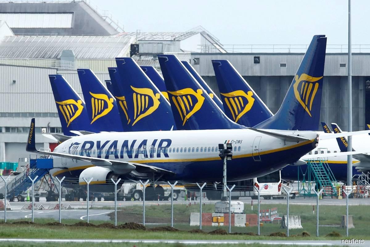 Ryanair slashes annual traffic target on 'draconian' UK, Irish lockdowns