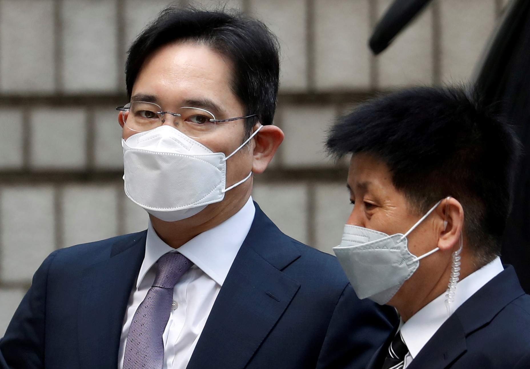Samsung conglomerate leader Jay Y Lee (left) (File photo by Reuters)