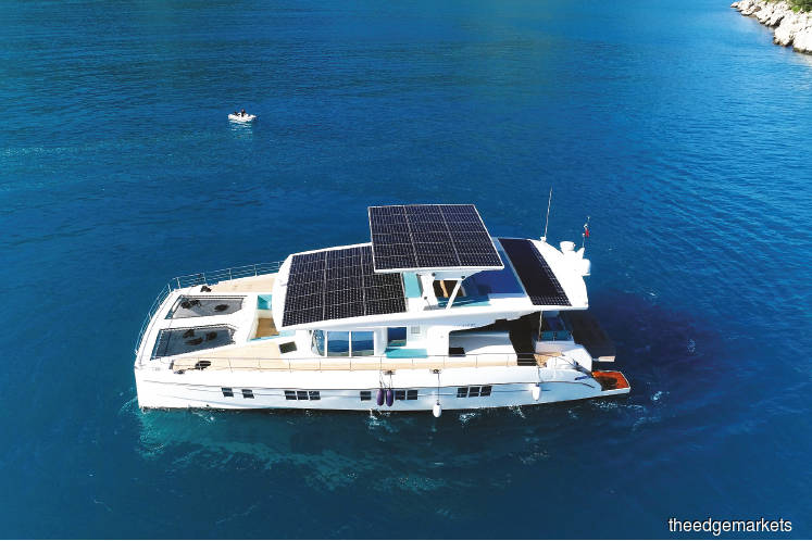 Serenity Yachts celebrates the US unveiling of the 'Serenity 64' luxury solar-powered yacht. (Photos by Bloomberg)