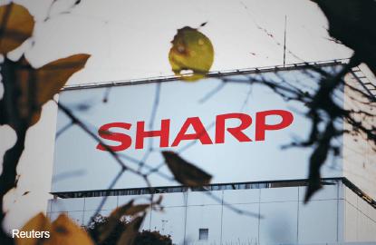 Sharp shares surge a third day in Tokyo