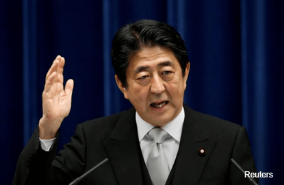 Japan PM Abe seeks Saudi support for Aramco listing in Tokyo