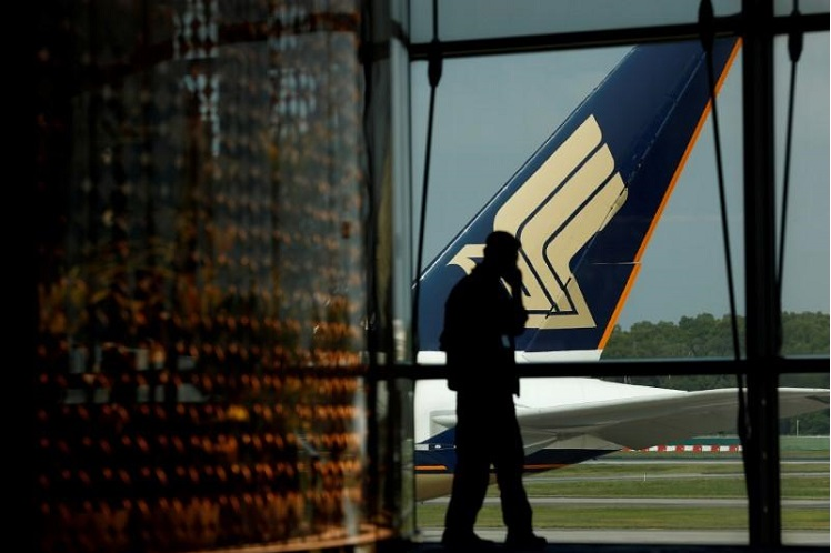 A Singapore Airlines plane sits on the tarmac at Singapore's Changi Airport March 11, 2020. Picture taken March 11, 2020. (Photo by Reuters)