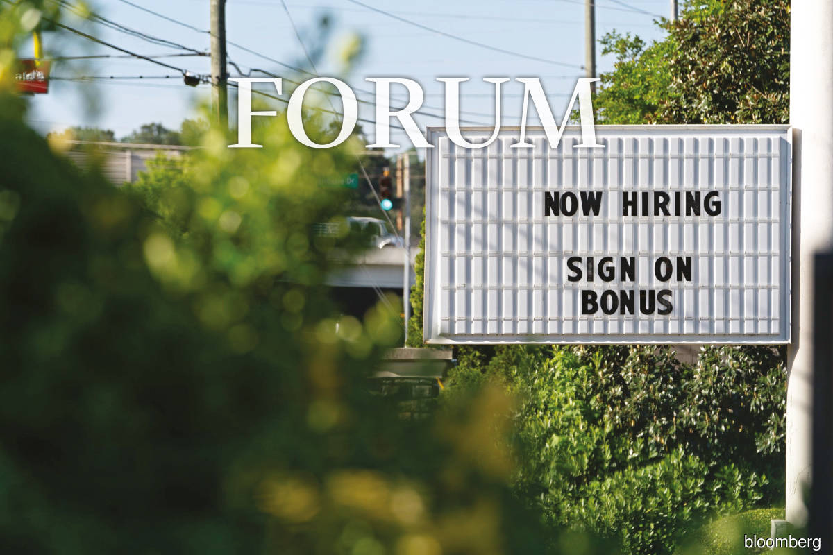 A sign outside a business in the US. The unemployment rate in the US continued to decline to 4.8% in September this year while inflation was at a 13-year high of 5.4%. (Photo by Bloomberg)