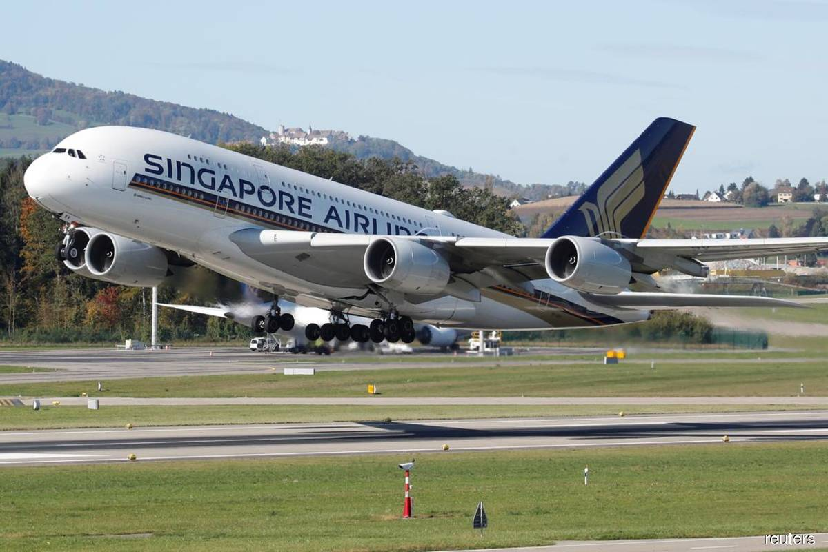 Singapore Airlines shares fall most in two decades after record loss
