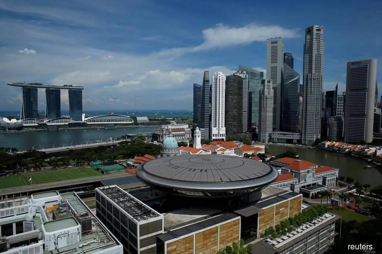 Singapore raises stakes for Macau casino permits: Katrina Hamlin