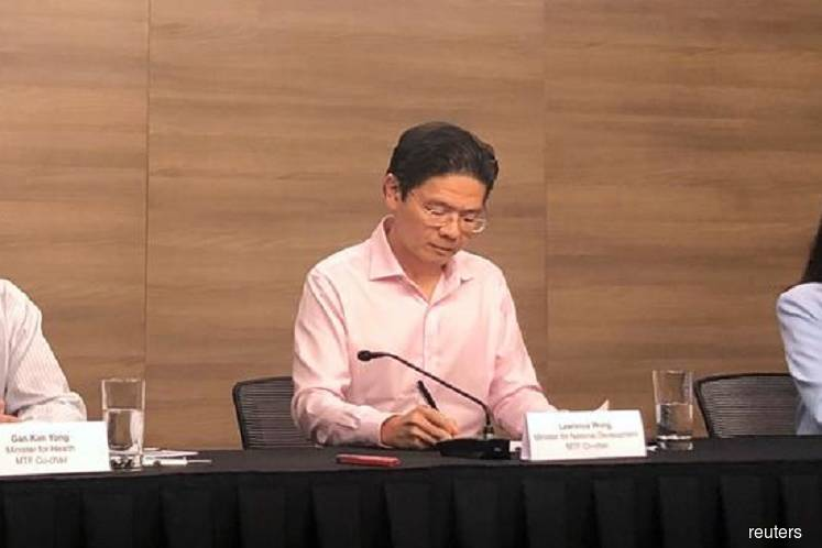 Singapore minister Lawrence Wong, who co-heads the country's virus fighting taskforce. (Photo by Reuters)