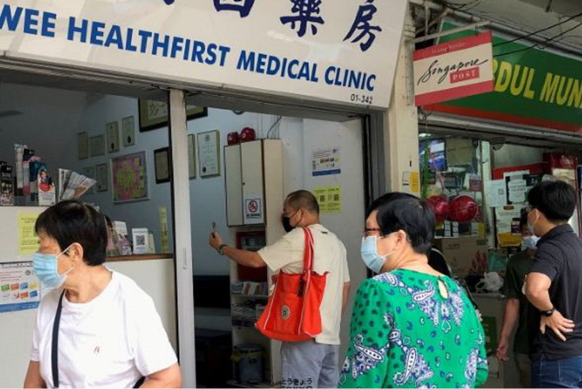 People queue to enquire about Sinovac vaccine at a clinic, during the Covid-19 outbreak in Singapore June 18, 2021. (Photo by Reuters)