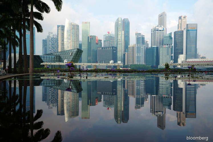 Rare Singapore hotel site gets record bid after cooling measures