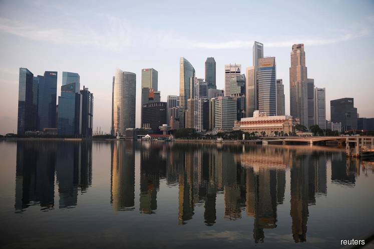 Singapore cautions wealth managers on aggressively courting HK business — sources