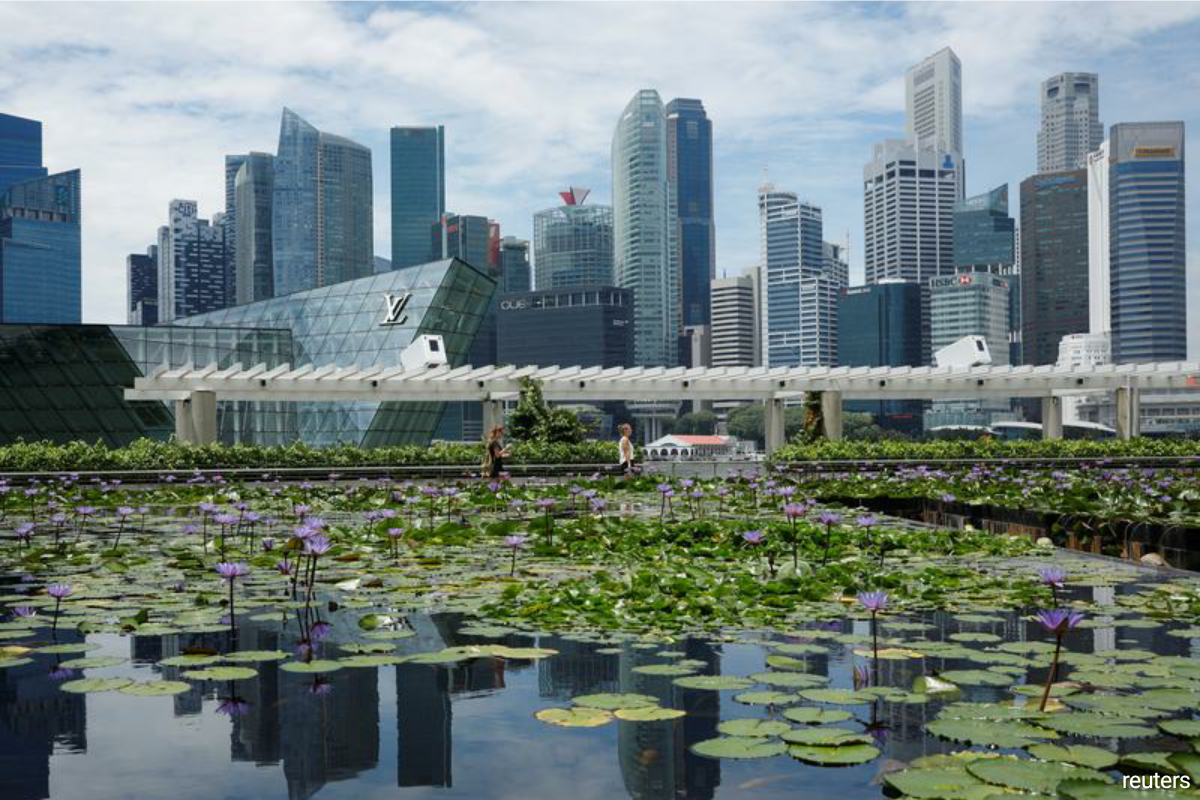 Britain says it's back as it signs trade deal in Singapore
