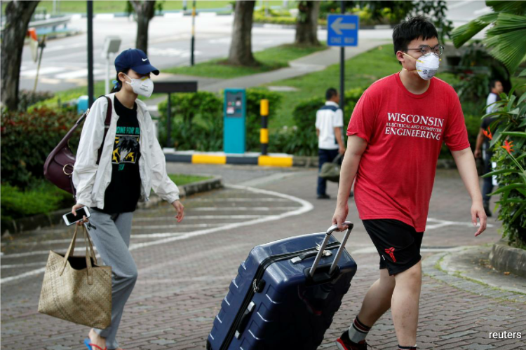 Singapore announced S$5.1 billion ($3.55 billion) in additional economic spending such as wage support, waiver of levies and one-off payments to combat the coronavirus pandemic. (Photo by Reuters)