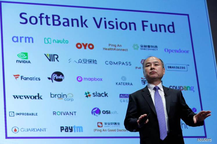 SoftBank Group shares tumble as Uber prices IPO at lower end