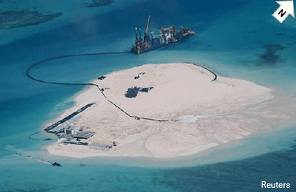 China finishing South China Sea buildings that could house missiles -U.S. officials
