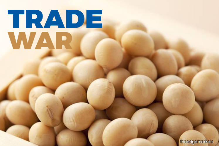 China puts U.S. soy buying on hold as tariff war escalates
