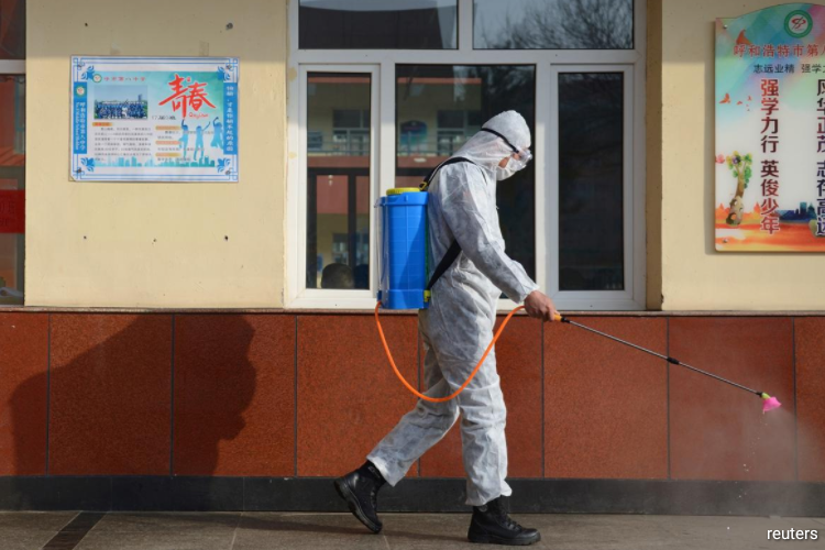 China, where the coronavirus emerged late last year, has managed to bring its outbreak under control and is easing travel restrictions in virus hot spots. (Photo by Reuters)