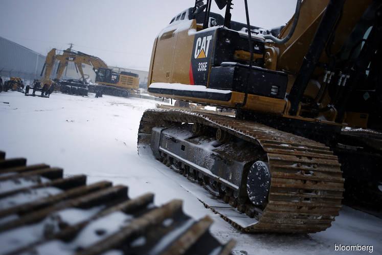 EU said ready to target Caterpillar, Xerox if U.S. hits cars
