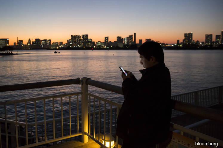 Japan delivers US$9 bil blow to mobile phone operators