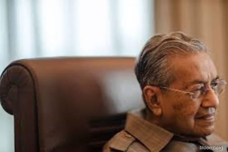 Malaysia's Mahathir seeks to cut national debt of 65% of GDP