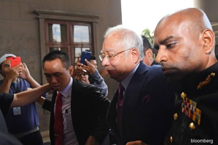 Former PM Najib pleads not guilty to four corruption charges