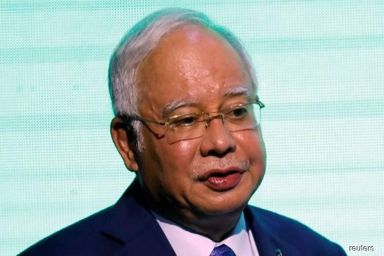 Ex-Malaysia PM to face graft probe as police seize jewellery, handbags