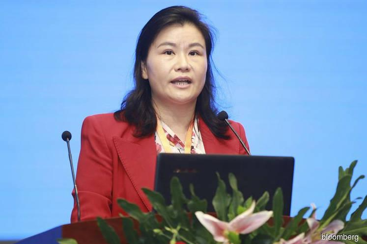 Once-richest woman becomes biggest loser in China wealth rout