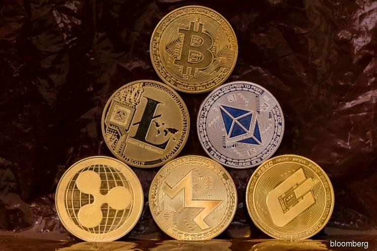 Crypto crash accelerates as bitcoin drops to fresh low for year