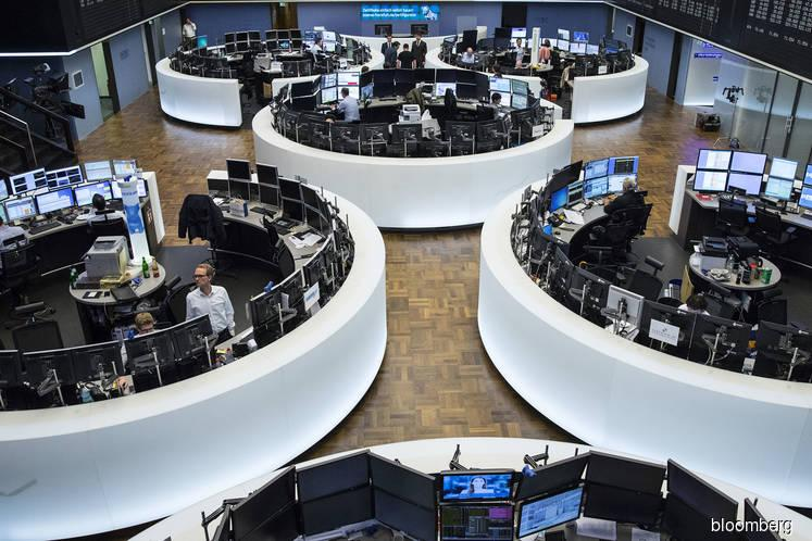 European shares fall further as mounting trade fears hit cyclicals