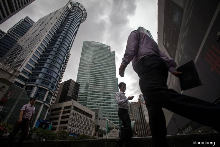 Singapore tightens foreign worker rules, beefs up cyber security