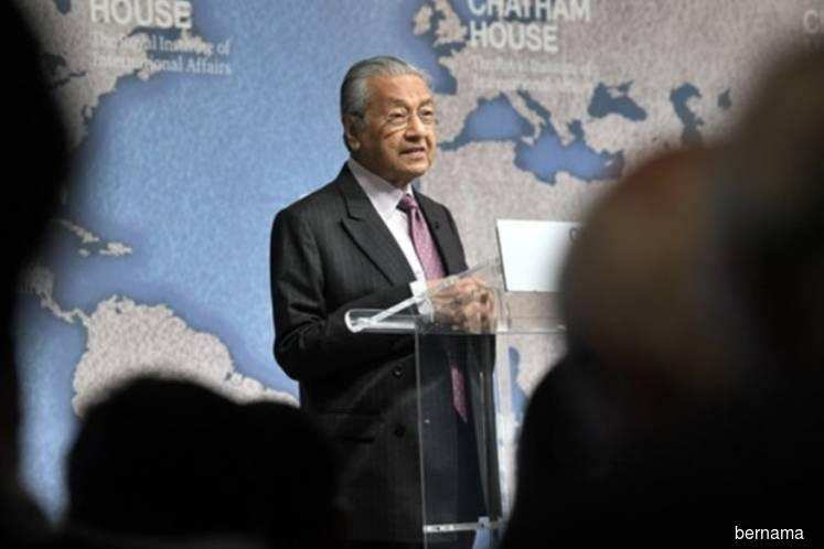 Malaysia concerned over megatrends in trade war between major powers — Tun M