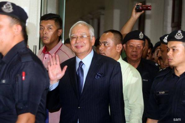 Najib charged with 21 counts of money laundering