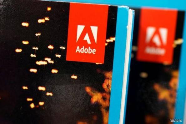 Adobe lifts profit forecast on tax reform boost