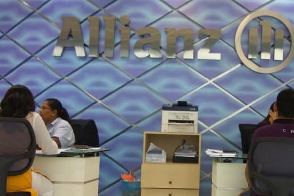 Allianz 4Q net profit sinks a little on higher flood claims