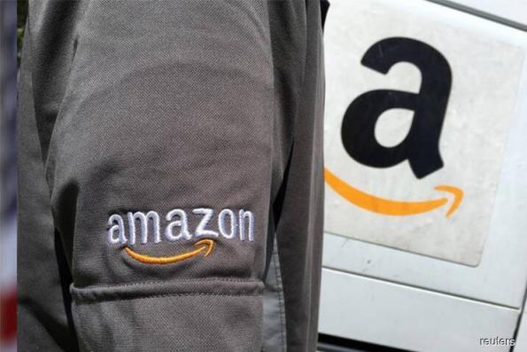 Amazon, Intel Earnings Boost Tech Momentum in Post-Market Surge